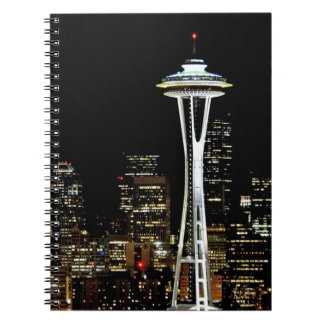 Seattle skyline at night, with Space Needle. Notebook