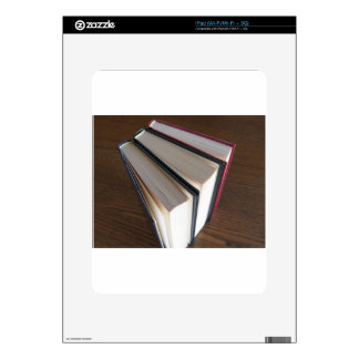 Second hand books standing on a wooden table skins for iPad