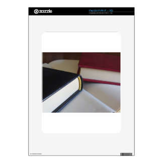 Second hand books with blank pages on a table decal for iPad