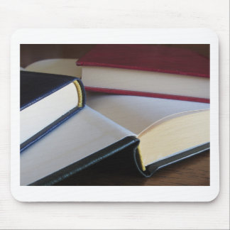 Second hand books with blank pages on a table mouse pad