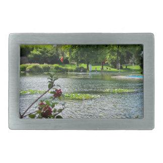 Secret pond on a beautiful sunny day rectangular belt buckle