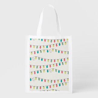 Secuencia del navidad del modelo de las luces bolsas de la compra