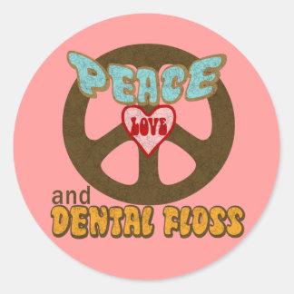 Seda dental del amor de la paz etiqueta redonda