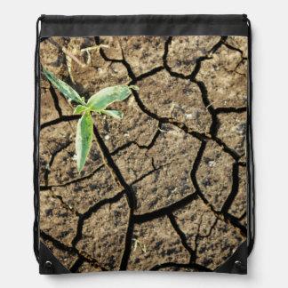 Seedling In Cracked Earth Drawstring Bag