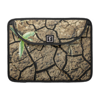 Seedling In Cracked Earth Sleeves For MacBooks