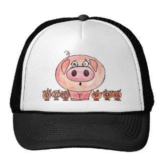 Seis pequeños cerdos gorras