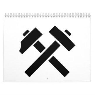 Selección del martillo cruzada calendario de pared