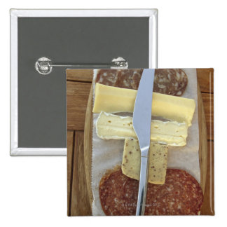 Selection of gourmet cheeses and cut meats buttons