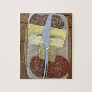 Selection of gourmet cheeses and cut meats jigsaw puzzle