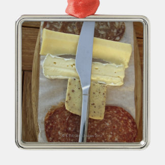 Selection of gourmet cheeses and cut meats metal ornament