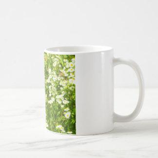 Selective focus of green field coffee mug