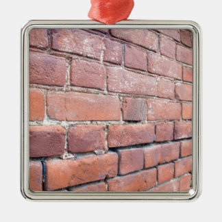 Selective focus on a brick wall at an angle metal ornament