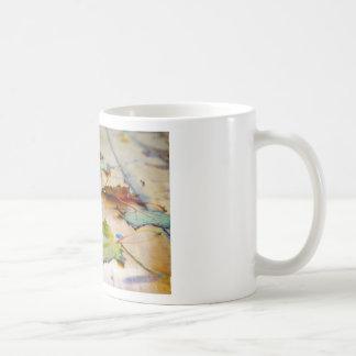 Selective focus on autumn maple leaves with shallo coffee mug