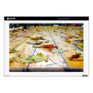 "Selective focus on fallen autumn maple leaves clos skin for 17"" laptop"
