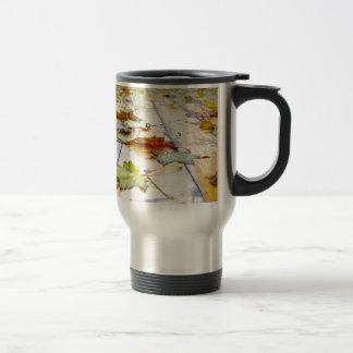 Selective focus on fallen autumn maple leaves clos travel mug