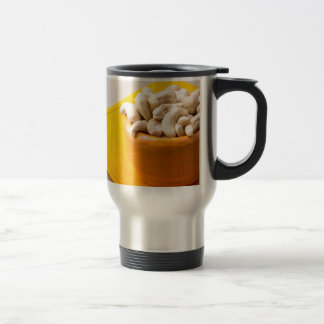 Selective focus on raw cashew nuts in a small cup