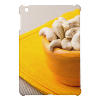 Selective focus on raw cashew nuts in a small cup iPad mini covers