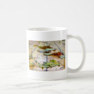 Selective focus on the autumn fallen maple leaves coffee mug