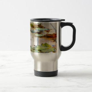 Selective focus on the autumn fallen maple leaves travel mug