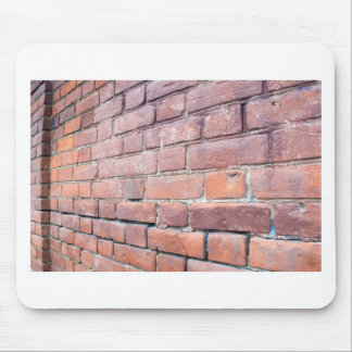 Selective focus on the red brick wall mouse pad