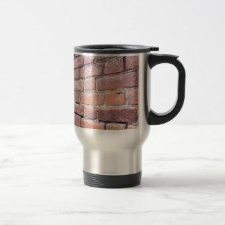 Selective focus on the red brick wall travel mug