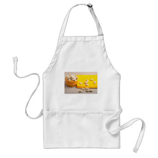 Selective focus on the tablecloth and raw cashew adult apron