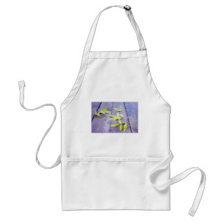 Selective focus on the yellow autumn leaves ash adult apron