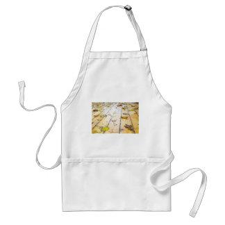 Selective focus on wet fallen autumn maple leaves adult apron