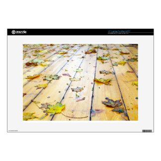 "Selective focus on wet fallen autumn maple leaves skin for 15"" laptop"