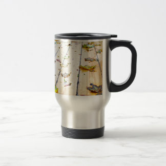 Selective focus on wet fallen autumn maple leaves travel mug