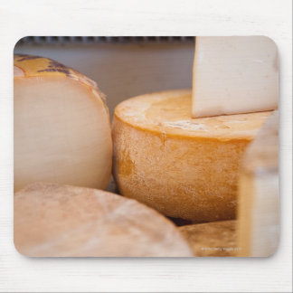 Selective focus photograph of cheeses in cheese mouse pad