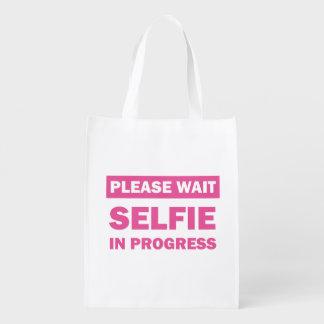 Selfie en curso bolsa para la compra