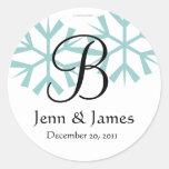 Sello azul del monograma B de los copos de nieve d Etiqueta