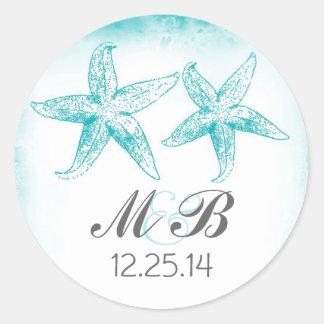 sello azul del monograma de las estrellas de mar pegatina redonda