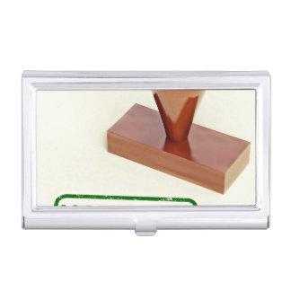Sello de goma produciendo la palabra natural cajas de tarjetas de negocios