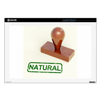 Sello de goma produciendo la palabra natural skins para 43,2cm portátil