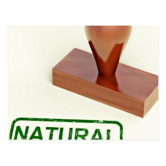 Sello de goma produciendo la palabra natural tarjeta postal