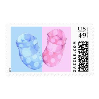 Sello de los botines de los gemelos del bebé