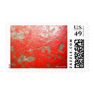 Sello de piedra pintado rojo macro