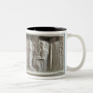 Sello del cilindro que representa una evocación a taza de café