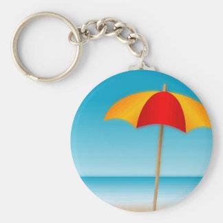 Sello del paraguas de la playa y del océano llaveros