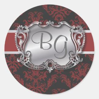 Sello elegante de color rojo oscuro y de plata del etiquetas redondas