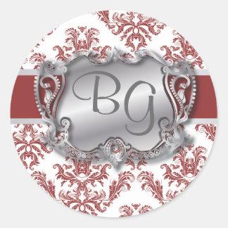 Sello elegante de color rojo oscuro y de plata del pegatina redonda