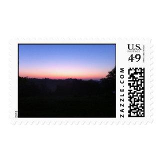 sello púrpura azul anaranjado de la puesta del sol