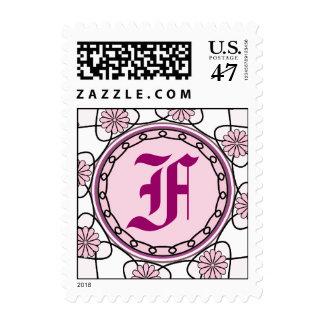 Sello rosado floral adornado de la letra F del