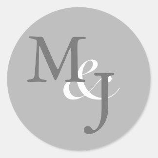 Sellos cones monograma grises claros del sobre del pegatina redonda