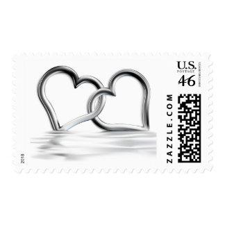 Sellos de plata entrelazados del amor de los coraz