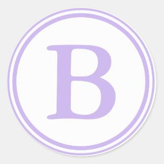Sellos púrpuras y blancos redondos del sobre con e pegatinas redondas
