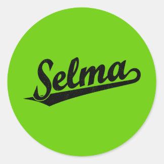Selma script logo in black distressed classic round sticker