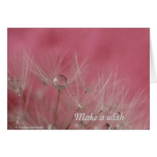 Semillas rosadas femeninas del diente de león de tarjeta de felicitación